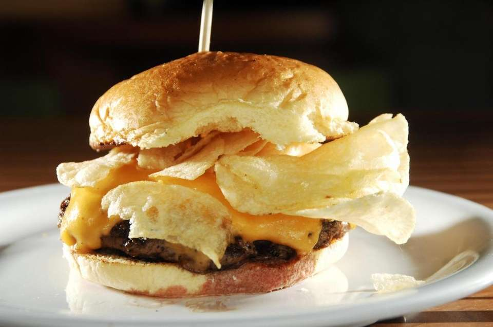 A potato-chip burger is served at chef Bobby