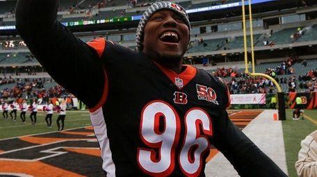 Bengals defensive end Carlos Dunlap celebrates after a
