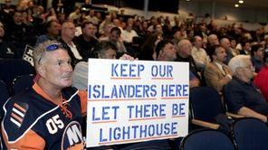 Patrick Dowd of Bay Shore listens to Islanders