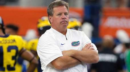 Florida head coach Jim McElwain watches his team
