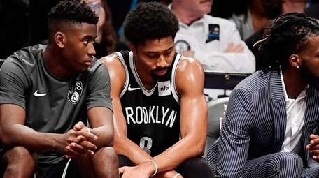 Spencer Dinwiddie of the Nets reacts late in