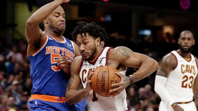 The Cavaliers' Derrick Rose drives to the basket