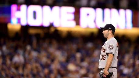 Justin Verlander of the Astros reacts after a