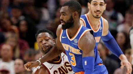The Cavaliers' Dwyane Wade fouls the Knicks' Tim