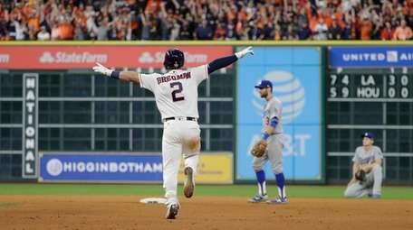 Houston Astros' Alex Bregman reacts after hitting in