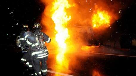 Jericho and Syosset firefighters battle a van fire