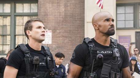 Alex Russell and Shemar Moore, right, star in