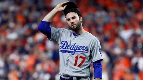 Brandon Morrow of the Dodgers looks on against the Astros
