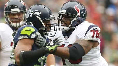 Duane Brown of the Texans blocks Dwight Freeney