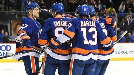 Islanders players celebrate power-play goal by John Tavares