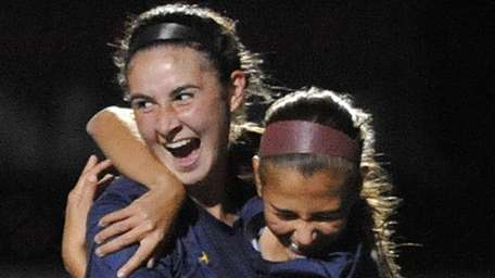 Kate Fiola of Massapequa, left, celebrates with Jaclyn