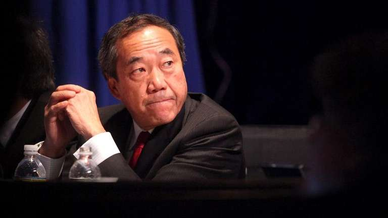 Charles Wang listens at a public zoning hearing
