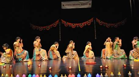 Children perform a Bollywood dance at the 2016