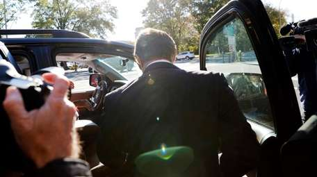 Paul Manafort gets into a car as he