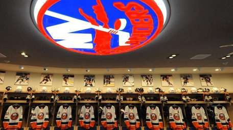 A lit New York Islanders logo illuminates the