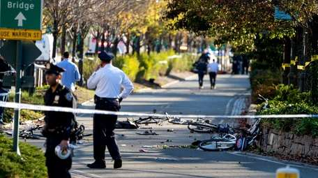 Bicycles and debris lay on a bike path