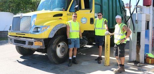 Patchogue Village sanitation workers Charlie Collins, left, Troy