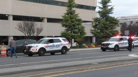 Nassau County police respond to the scene where