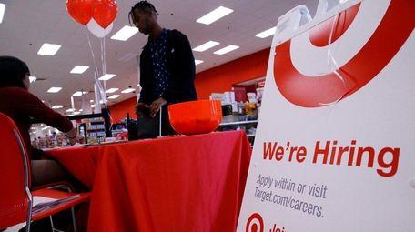 A job seeker, standing, talks with a Target