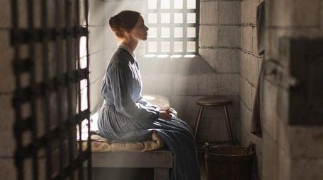 Sarah Gadon stars as a woman in prison