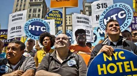 Labor union members and supporters rally for better