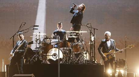 U2 performs onstage at the National Stadium in