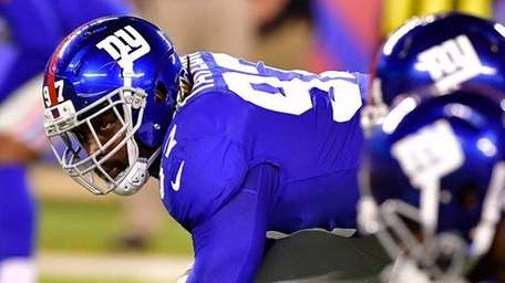 The Giants' Devin Taylor lines up against the Steelers
