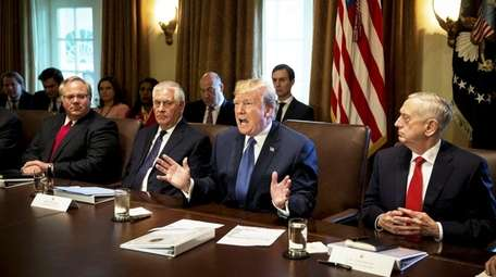 U.S. President Donald Trump, second right, speaks while