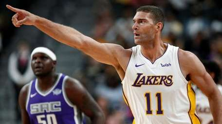 Lakers center Brook Lopez points to the fans