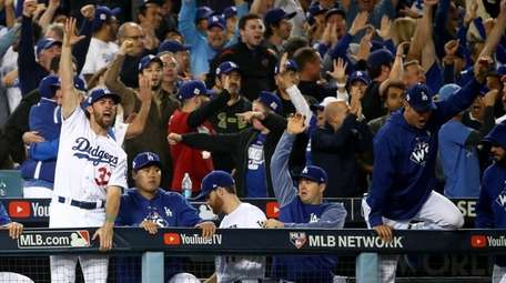 The Dodgers' Charlie Culberson celebrates during Game 6