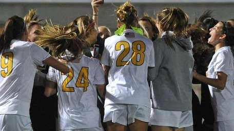St. Anthony's teammates celebrate after their win over