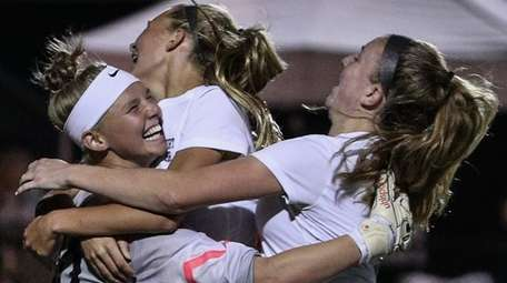 Goalkeeper Emma Havrilla celebrates Northport's win with her