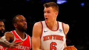 Knicks forward Kristaps Porzingis drives during a game