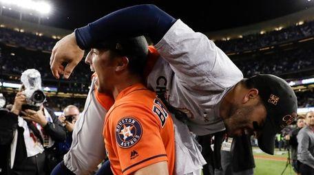 The Astros' Alex Bregman lifts Jose Altuve as