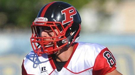 Plainedge quarterback Mike Ciuffo looks for a receiver