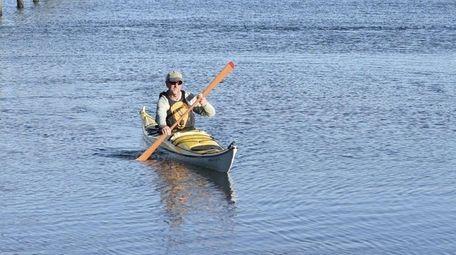 Steve Berner kayaks in the water off Nissequogue