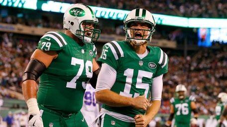 Jets quarterback Josh McCown (15) celebrates with teammate