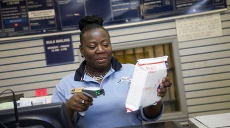 Cleon Pompey-Gerald at work at the post office