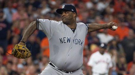Yankees pitcher CC Sabathia throws a pitch during