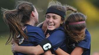 Morgan Camarda #6 of Massapequa, center, celebrates with