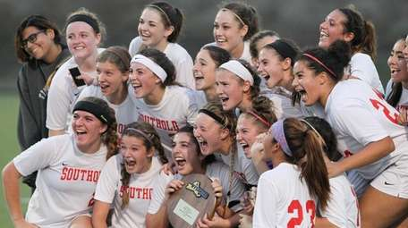 Southold/Greenport players celebrate their win in the Southeast