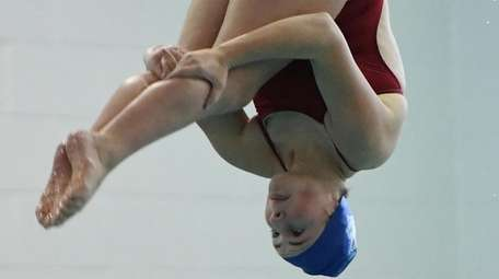 Patricia Arceri of Huntington executes a dive during