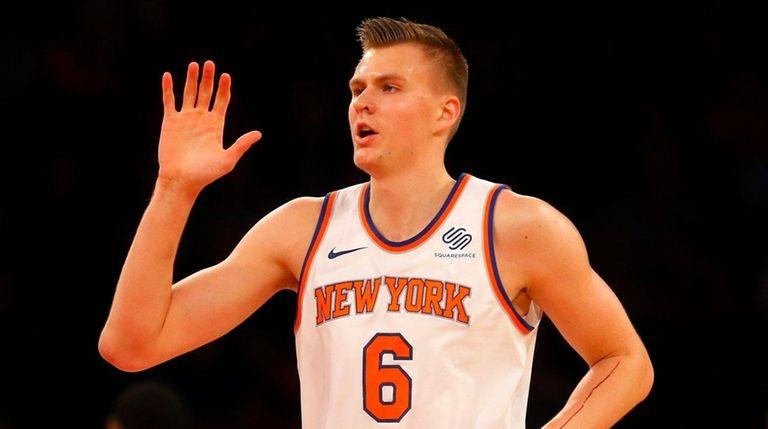 Knicks forward Kristaps Porzingisreacts after a basket during
