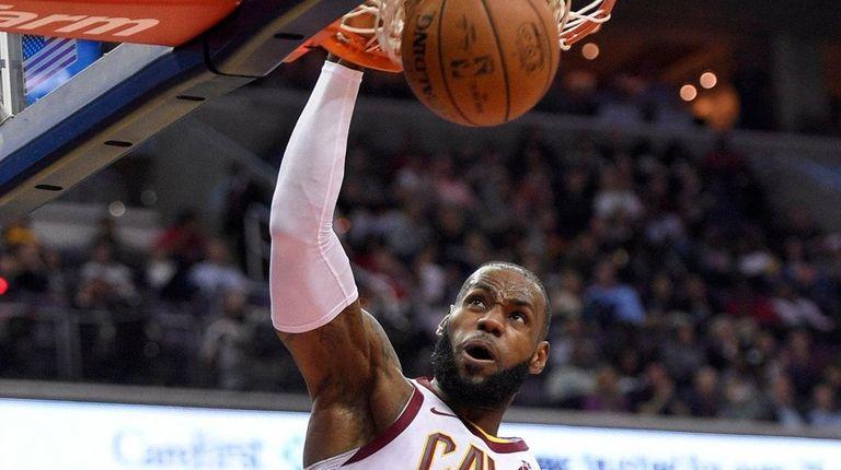 0d801b4eaa23 Cavaliers forward LeBron James dunks during a game