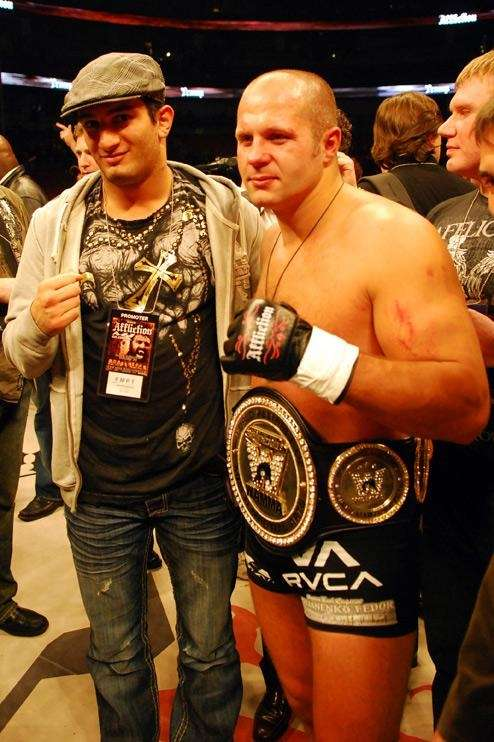 Fedor Emelianenko poses for photos after knocking out