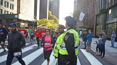 NYPD officers stood guard as runners began a