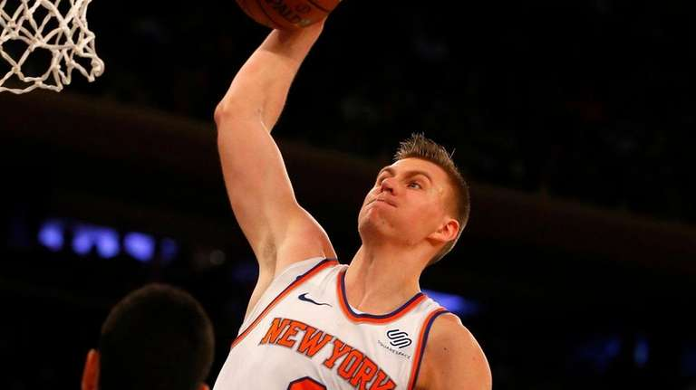 Knicks forward Kristaps Porzingis goes up for a