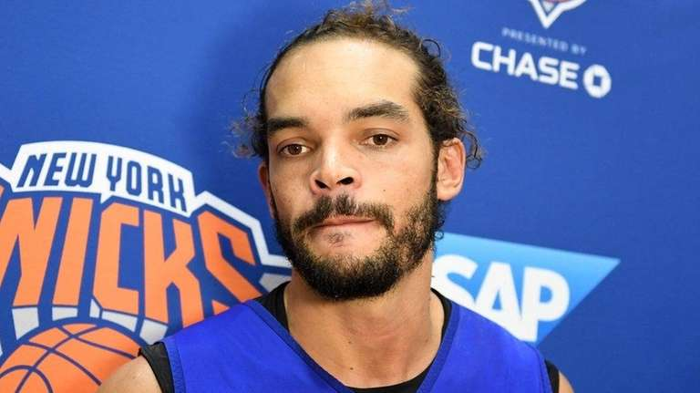 Joakim Noah speaks to the media after practice at