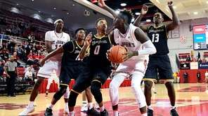 Bashir Ahmed of the St. John's attempts a