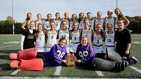 The Ward Melville field hockey team celebrates its